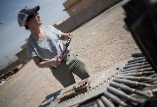 Field investigator photographing captured ISIS ammunition, West Mosul